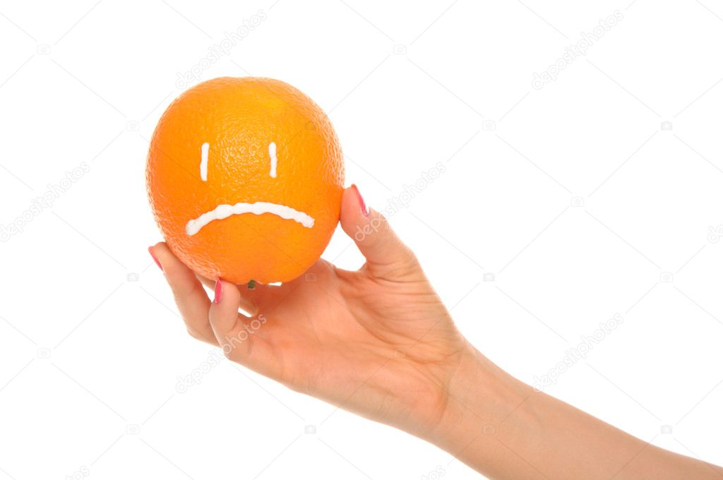 Hand holds orange with drawn insult isolated in white — Stock Photo #4862641