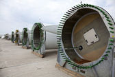 Giant wind turbine awaiting assembly at wind farm. — Stock Photo