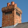 Brick chimney - Stock Photo