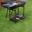 Outdoor barbecue grill -  