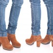 Woman legs in jeans - Stock Photo