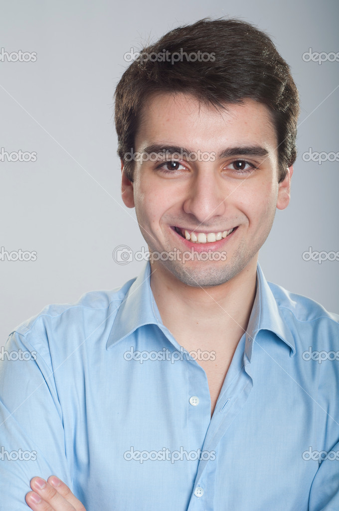 Portrait of a smiling handsome trainee starting business career  Stock Photo #5363000