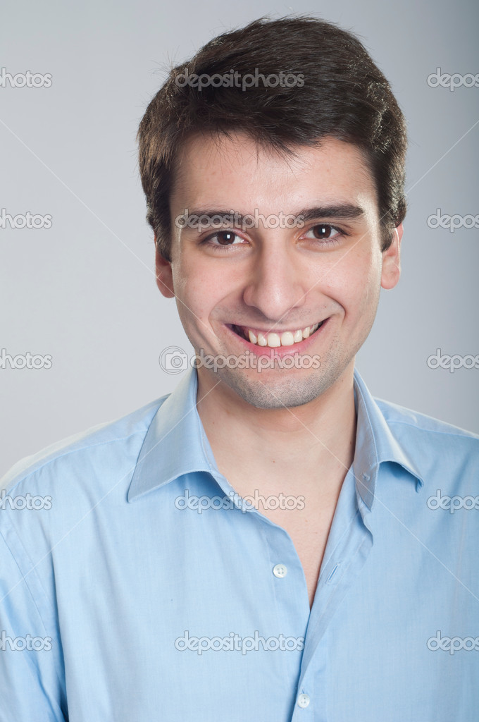 Portrait of a smiling handsome trainee starting business career  Stock Photo #5363006