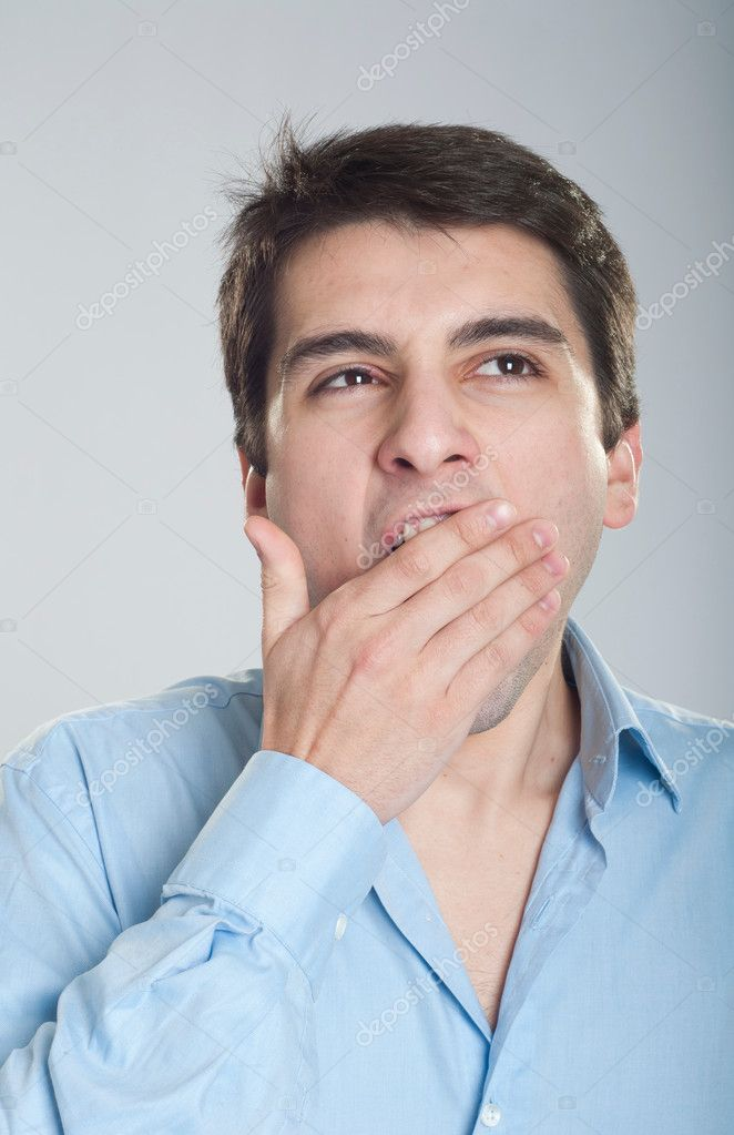 Portrait of a young business man yawning — Stock Photo #5363017