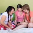 Teens reading text messages - Stock Photo