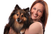 Woman and furry dog — Stock Photo
