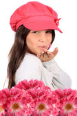 Blowing kiss and flowers — Stock Photo