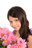 Pretty eight year old girl with flowers — Stock Photo