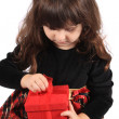 Girl opening present — Stock Photo