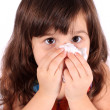 Little girl wiping nose with tissue — Stock Photo #4338176
