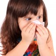 Little girl wiping nose with tissue — Stock Photo
