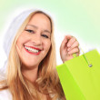blonde dame shopper in winter slijtage — Stockfoto