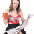 Girl with coffee and newspaper — Stock Photo #4841201