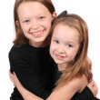 Two young girls hugging — Stock Photo