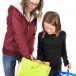 Two girls looking in bags — Stock Photo