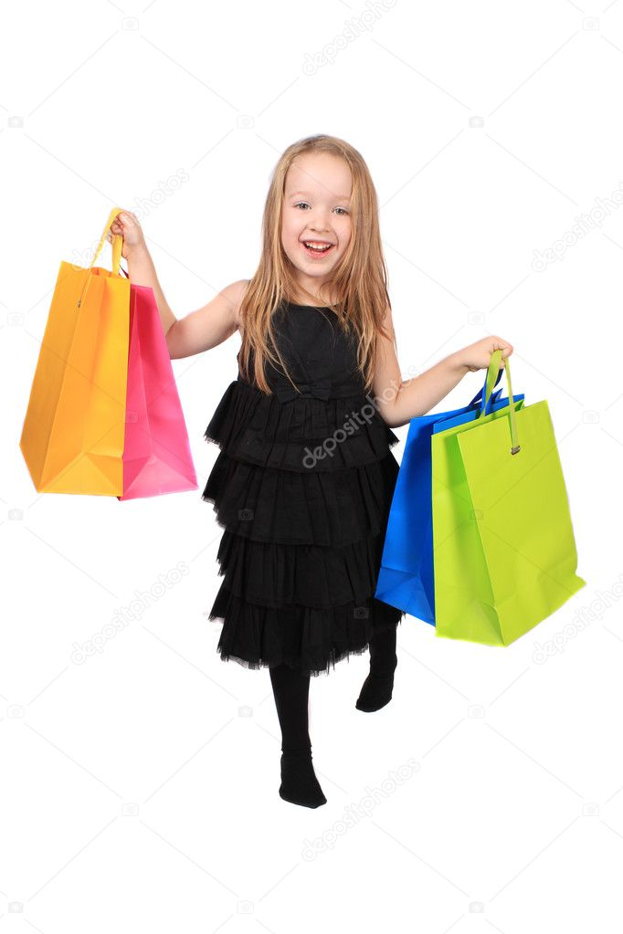 Cute little four year old  blonde girl holding colorful  gift bag on a white background — Stock Photo #5061134