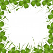 Four leaves clover and grass frame — Stock Photo #4004886