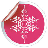 Red snowflake label — Stock Photo