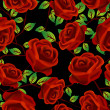 Roses over black pattern — Stock Photo