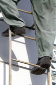 Feet person ladder — Stock Photo