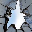Stock Photo: Glass broken hole cracks