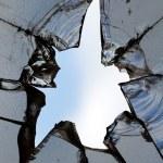 Glass broken hole cracks — Stock Photo