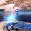 Worker welder pipe road — Stock Photo