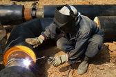Worker welder repair pipeline — Stock Photo