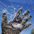 Hand  glass  hole  destruction  barrier - Stock Photo