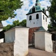 Porvoo, Finland. Old stone Church gate and belfry - Stock Photo