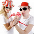 Young happy couple with candies — Stock Photo
