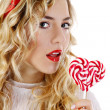 Beautiful girl with a heart candy — Stock Photo