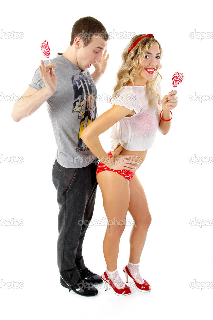 Young couple with candies in the shape of hearts  Stock Photo #4853124