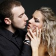 Handsome man is about to kiss a beautiful woman — Stock Photo