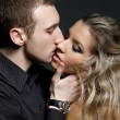 Royalty-Free Stock Photo: Handsome man kissing a beautiful woman