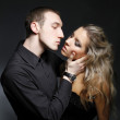 Handsome man is about to kiss a beautiful woman — Stock Photo #5134408