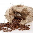 Burlap sack of roasted beans — Stock Photo