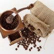 Coffee mill with burlap sack of roasted beans — Stock Photo