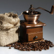 Stock Photo: Coffee mill with sack of roasted beans