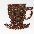 Roasted beans gathered in a shape of coffee cup — Stock Photo