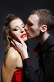 Man kissing woman with smeared lipstick — Stock Photo