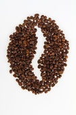 Roasted beans gathered in a shape of coffee bean — Stock Photo