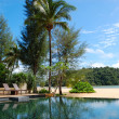 Swimming pool at the beach of luxury hotel, Phuket, Thailand - Stock Photo