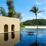 Palm tree at the beach and swimming pool, Phuket, Thailand — Stock Photo #4186267