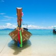 Traditional Thai style boat on turquoise water at the beach of P — Stock Photo #4564052