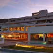 Restaurant's illumination of luxury hotel during sunset, Crete, - Стоковая фотография