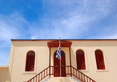 Old Greek religious building and flag, Crete, Greece — Stock Photo
