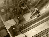 Magnifier, ruler and calculator, collage in sepia — Stock Photo