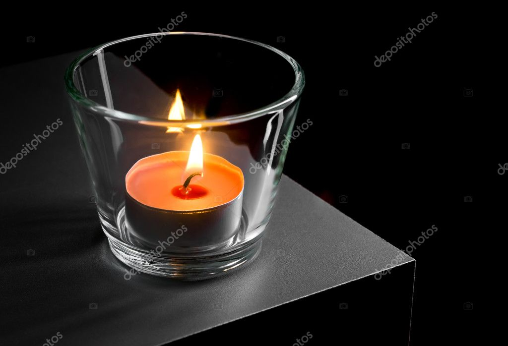 Burning candle in glass on black background — Stock Photo #4570077