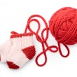 Isolated red skein and knitted socks — Stock Photo